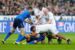 France Inside Centre Maxime Mermoz is tackled by England Prop Mako Vunipola - Mandatory byline: Rogan Thomson/JMP - 19/03/2016 - RUGBY UNION - Stade de France - Paris, France - France v England - RBS 6 Nations 2016.