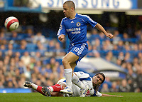 Photo: Daniel Hambury.<br />Chelsea v Portsmouth. The Barclays Premiership. 21/10/2006.<br />Chelsea's Joe Cole is challanged by Portsmouth's Pedro Mendes.