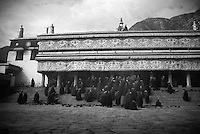 Monks entering Labrang Monastery, Xiahe in China for prayer sessions.
