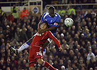 Photo: Rich Eaton.<br /> <br /> Birmingham City v Liverpool. Carling Cup. 08/11/2006. Cameron Jerome at rear of Birmingham City outjumps Gabriel Paletta of Liverpool