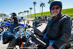 Jim Cain ready to head out on a Fatboy Low test ride from the Harley-Davidson display during Daytona Bike Week, FL, USA. March 8, 2014.  Photography ©2014 Michael Lichter.