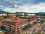 """16 JUNE 2016 - PAKSE, CHAMPASAK, LAOS: The uncompleted but already in use Champasak Shopping Center in Pakse. The three story shopping center (only the ground floor is fully open) is more like a market with small family owned shops selling clothes. There is a """"wet"""" market (a fruit and produce market) next to it. Pakse is the capital of Champasak province in southern Laos. It sits at the confluence of the Xe Don and Mekong Rivers. It's the gateway city to 4,000 Islands, near the border of Cambodia and the coffee growing highlands of southern Laos.      PHOTO BY JACK KURTZ"""