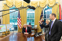 October 10, 2018 - Washington, DC, United States of America - U.S President Donald Trump is briefed by FEMA Administrator Brock Long, right, and Homeland Security Secretary Kirstjen Nielsen on Hurricane Michael as it heads to Florida in the Oval Office of the White House October 10, 2018 Washington, DC. Hurricane Michael is the most powerful storm ever to hit the panhandle region of Florida (Credit Image: © Shealah Craighead via ZUMA Wire)