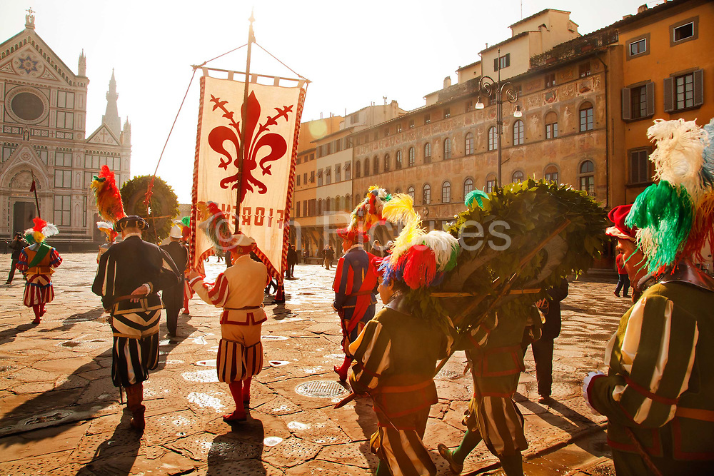 St Stephens Square. Traditional procession to mark the beginning of Carnival in the city of Florence. A parade in historical costume that starts at the Church of Santa Maria Novella and ends at the Church of Santa Croce in St Stephens Square.<br /> the city of Florence celebrated carnival twice annually. These festivals took place before Lent and during Calendimaggio, which celebrated the return of spring beginning on May 1 and ending on the feast day of John the Baptist, the patron saint of Florence. People from all classes of society gathered in the streets of Florence and participated in processions, parades, singing, dancing, and revelry.