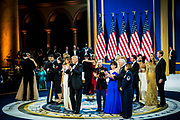 U.S. President Donald Trump, First Lady Melania Trump,  Vice President Mike Pence, Second Lady Karen Pence and Trump family members dance with members of the armed services during the Armed Services Inaugural Ball in Washington, D.C., on Friday, Jan. 20, 2017. Senate Democrats and Republicans are tussling over how many of Trump's nominees can be confirmed on his first day in office, with Republicans threatening to work through the weekend to break the logjam.