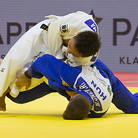 Miklos Ungvari (bottom) of Hungary and Masashi Ebinuma (top) of Japan fight during the Men -73 kg category at the Judo Grand Prix Budapest 2018 international judo tournament held in Budapest, Hungary on Aug. 11, 2018. ATTILA VOLGYI