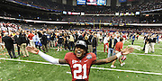 Daily Photo by Gary Cosby Jr.    ..Dre Kirkpatrick celebrates on the field after Alabama defeated LSU 21-0 to claim their 14th National Championship...................................