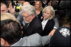 """Artist and television personality Rolf Harris leaves with his wife Alwen Hughes The City of Westminster Magistrates Court, London, England. Mr Harris, who was arrested in March by police officers working for Operation Yewtree, has been charged with nine counts of indecent assault on teenage girls and four counts of making indecent images of children, United Kingdom. Monday, 23rd September 2013. Picture by Andrew Parsons / i-Images<br /> File photo - Rolf Harris is facing three further prosecutions for sexual assault including one against girl """"aged seven or eight"""", prosecutors have said.<br /> Photo filed Monday 23rd December 2013"""
