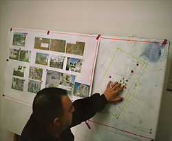 Maj. Mohammed Qabraqi, 43, of the Explosive Ordinance Department of the Gaza Police, shows diagrams during an investigation into allegations that Israeli airstrikes mistakenly targeted civilian residences in Beit Hanoun, Gaza Strip, Palestinian Territories, Nov. 24, 2006.