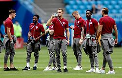 England's John Stones (left), Danny Rose, Jordan Henderson, Jordan Pickford, Danny Welbeck and Harry Kane (right) inspect the pitch before the FIFA World Cup, Quarter Final match at the Samara Stadium.