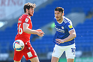 Cardiff City's Kieffer Moore (10) turns Nottingham Forest's Scott McKenna (26) during the EFL Sky Bet Championship match between Cardiff City and Nottingham Forest at the Cardiff City Stadium, Cardiff, Wales on 2 April 2021.