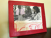 Double sided with red tape sign from inside grocery 11x13 in photos on front bw/photo and pic of dennis on back with lady..with red tape on edges<br />