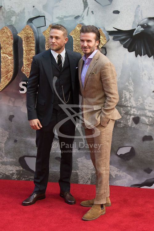 London, May 10th 2017. David Beckham poses with Charlie Hunnam as they attend the European premiere of King Arthur - Legend of the Sword at the Cineworld Empire in Leicester Square.