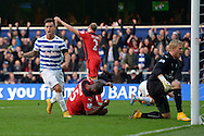 Eduardo Vargas of Queens Park Rangers celebrating after Wes Morgan, the Leicester City Captain (centre) scores an own goal to make it 1-1. Barclays Premier league match, Queens Park Rangers v Leicester city at Loftus Road in London on Saturday 29th November 2014.<br /> pic by John Patrick Fletcher, Andrew Orchard sports photography.
