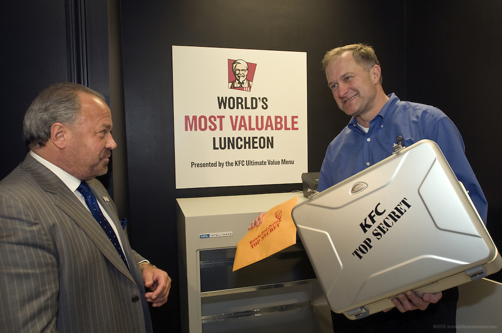 This handout photo from KFC shows corporate security expert Bo Dietl, left, watching as Roger Eaton, president of KFC USA, places Colonel Harland Sanders' handwritten Original Recipe of 11 herbs and spices into KFC headquarters' newly modernized and remodeled vault  Monday, Feb. 9, 2009 in Louisville, Ky. KFC launched it's new Ultimate Value Menu, with items priced at 99 cents, $1.49 and $1.99, by bringing back Colonel Sanders' hand-written Original Recipe after five months in an undisclosed location. (Photo by Brian Bohannon).