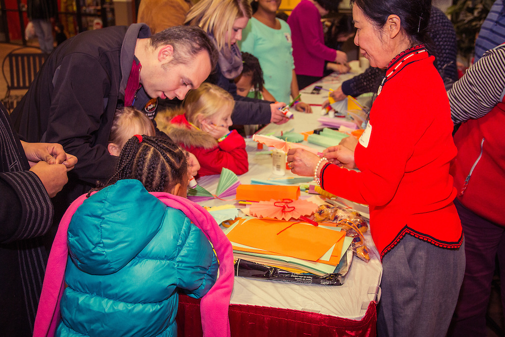 Asian Services in Action, Inc. hosts a craft activity at First Night Akron 2015