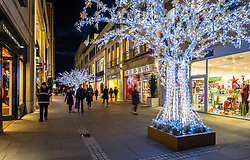 Night view of Multrees Walk upmarket shopping street with Christmas lights off St Andrews Square in Edinburgh , Scotland, United Kingdom.