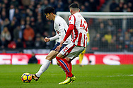 Son Heung-min of Tottenham Hotspur (L) holds off Thomas Edwards of Stoke City (R). Premier league match, Tottenham Hotspur v Stoke City at Wembley Stadium in London on Saturday 9th December 2017.<br /> pic by Steffan Bowen, Andrew Orchard sports photography.