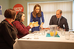 The Duke and Duchess of Cambridge serve lunch during a visit to Centrepoint in Barnsley.