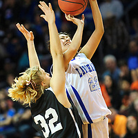 031413  Adron Gardner/Independent<br /> <br /> Laguna Acoma Hawk Aubree Carr (22) releases a shot over Clayton Yellowjacket Kristi Wagner (32) during the 2A New Mexico High School Basketball tournament semifinals at the Santa Ana Star Center in Rio Rancho Thursday.