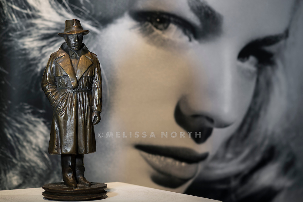 A german patinated bronze figure of Humphrey Bogart as Sam Spade cast by the Otto Strehle Foundry, second half 20th Century, est £390-520, at a preview of the auction highlights from the Estate of Lauren Bacall, at Bonhams, London, UK on 13th February 2015. The preview of 50 selected lots features works by Henry Moore, David Hockney, Robert Graham, Noel Coward and Jim Dine - and is due to be auctioned at Bonhams New York on 31 March and 1 April 2015.