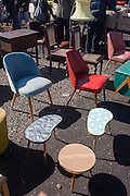 1950s-era chairs and assorted furniture, bric-a-brac and old possessions being sold at a giant market in Mauerpark - an open space on the site of the old Berlin wall, the former border between Communist East and West Berlin during the Cold War.
