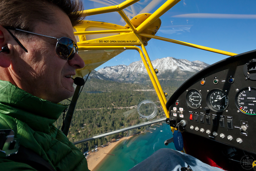 """""""Pilot over Lake Tahoe 1"""" - This pilot was photographed flying an amphibious seaplane over Lake Tahoe, CA."""