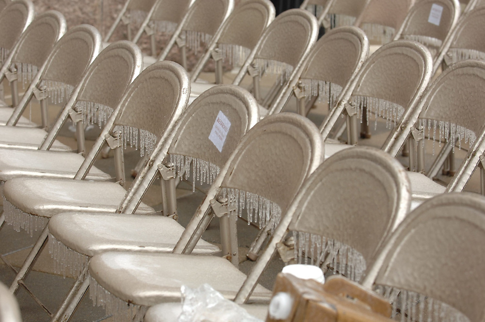 Austin, Texas:  A rare ice storm has left the region coated with ice, forcing the outdoor inaugural ceremony of Governor Rick Perry indoors for the first time since 1957. Chairs, set up for the outdoor ceremony, covered in a sheet of ice. January 17, 2007 ©Bob Daemmrich /