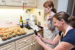 Students Susie Mullen, right and Hazel Griffiths admire their handiwork. Baker Liz Wilson leads classes where participants learn a number of baking methods at her Fulham home in London. London, August 16 2019.