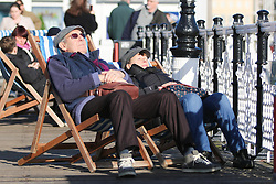 © Licensed to London News Pictures. 24/01/2015. Brighton, UK. People sunbathing on Brighton Pier. A sunny day in Brighton and the South Coast with temperatures expected to reach a maximum of 7C down the South Coast. Photo credit : Hugo Michiels/LNP