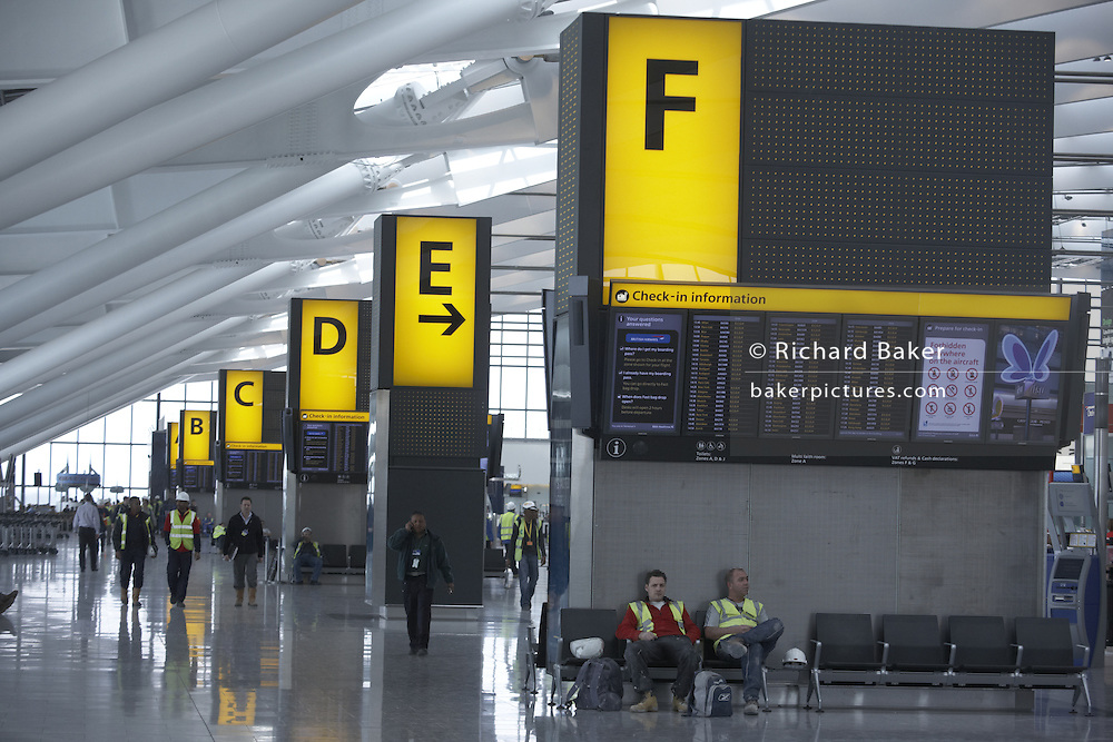 Flight departures information boards in landside Departures area newly-opened London Heathrow Airport's Terminal 5 building.
