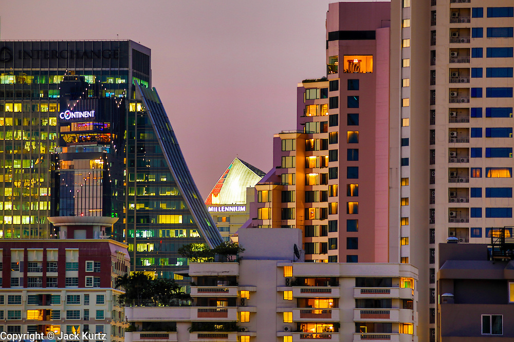 02 MAY 2013 - BANGKOK, THAILAND:  A compressed telephoto lens photograph of some of the residential condominium buildings in Bangkok, Thailand at sunset.   PHOTO BY JACK KURTZ