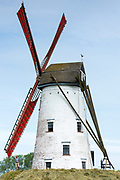 Traditional Schellemolen windmill with red painted sails at Damme, province of West Flanders in Belgium
