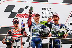 © Licensed to London News Pictures. 20/10/2012. Valentino Rossi (ITA), Jorge Lorenzo (SPA) & Dani Pedrosa celebrate on the podium during the Race day of the round 16 2013 Tissot Australian Moto GP at the  Phillip Island Grand Prix Circuit Victoria, Australia. Photo credit : Asanka Brendon Ratnayake/LNP