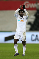 Wilfried Bony of Swansea city applauds the Swansea fans at the end of the match. Premier league match, Swansea city v West Bromwich Albion at the Liberty Stadium in Swansea, South Wales on Saturday 9th December 2017.<br /> pic by  Andrew Orchard, Andrew Orchard sports photography.