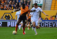 Scott Wootton fouls Bakary Sakho by pulling his shirt during the Sky Bet Championship match between Wolverhampton Wanderers and Leeds United at Molineux, Wolverhampton, England on 6 April 2015. Photo by Alan Franklin.