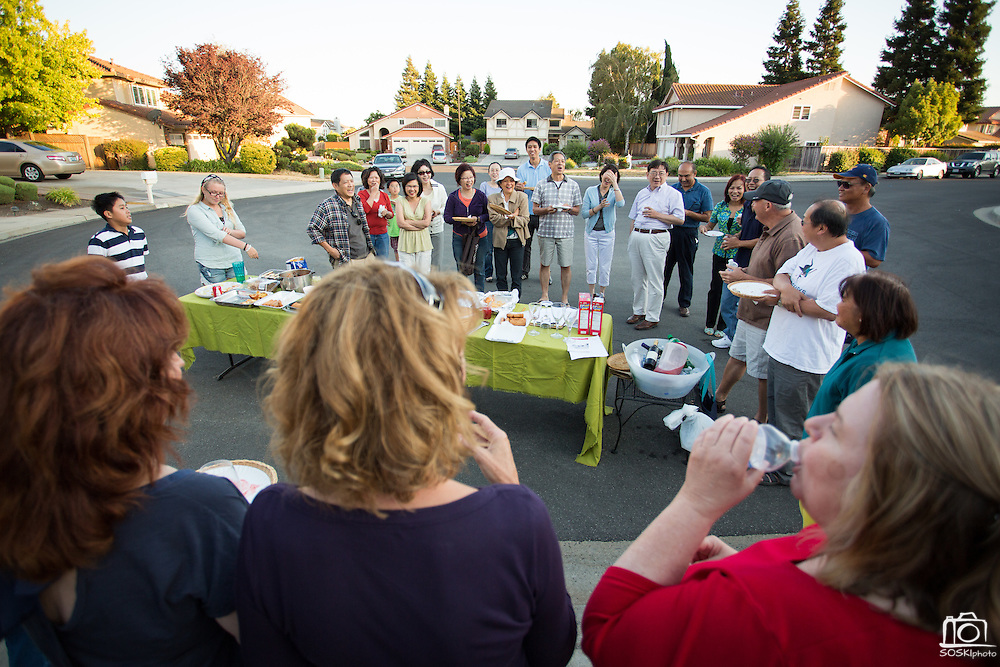 Friends and neighbors introduce themselves during the Princess Place National Night Out party in Milpitas, California, on August 8, 2013. (Stan Olszewski/SOSKIphoto)