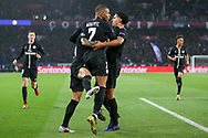 Kylian Mbappe of Paris Saint-Germain celebrates with Marquinhos of Paris Saint-Germain a goal for Juan Bernat of Paris Saint-Germain (Not in picture) 1-1 during the Champions League Round of 16 2nd leg match between Paris Saint-Germain and Manchester United at Parc des Princes, Paris, France on 6 March 2019.