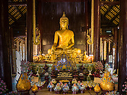 03 APRIL 2016 - CHIANG MAI, THAILAND:  The viharn or prayer hall at Wat Phan Tao in Chiang Mai. It is one of the few all wooden temples left in Chiang Mai and once served as a palace for one of Chiang Mai's kings before it was absorbed into Siam (now Thailand).     PHOTO BY JACK KURTZ