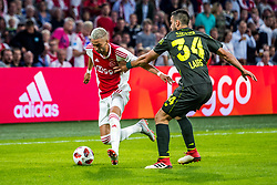14-08-2018 NED: Champions League AFC Ajax - Standard de Liege, Amsterdam<br /> Third Qualifying Round,  3-0 victory Ajax during the UEFA Champions League match between Ajax v Standard Luik at the Johan Cruijff Arena / Hakim Ziyech #22 of Ajax, Konstantinos Laifis #34 of Standard Liege