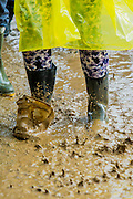 The rains return forcing people to shelter inany available space and  leading to mud and rainbows. The 2014 Glastonbury Festival, Worthy Farm, Glastonbury. 27 June 2013.  Guy Bell, 07771 786236, guy@gbphotos.com