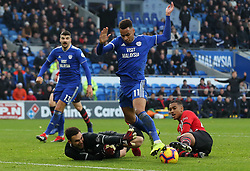 Southampton goalkeeper Alex McCarthy knocks the ball away from Cardiff City's Josh Murphy during the Premier League match at the Cardiff City Stadium, Cardiff.