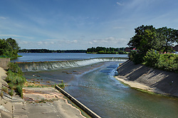 11 February 2015:    Lake Bloomington at the spillway.  The lake is at full level due to recent rainfall that has amounted to about twice he normal average.  The extra rain has come in showers hard enough to was lots of debris up and over the retaining wall leaving some teetering on the top.<br /> <br /> This image was produced in part utilizing High Dynamic Range (HDR) processes.  It should not be used editorially without being listed as an illustration or with a disclaimer.  It may or may not be an accurate representation of the scene as originally photographed and the finished image is the creation of the photographer.