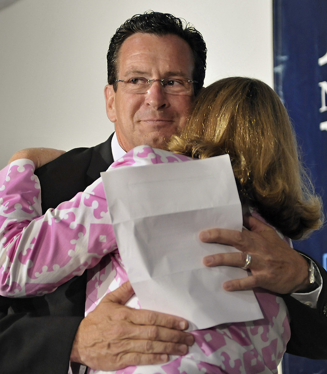 Dan Malloy hugs his wife Cathy after winning the Democratic nomination for governor in Hartford, Conn., on Tuesday, Aug. 10, 2010.   (AP Photo/Jessica Hill)
