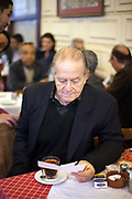 A journalist reads a letter after a rally in the crowded Cafe Riche, Cairo, Egypt