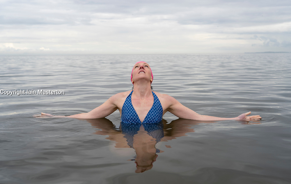 Edinburgh, Scotland, UK. 6 August, 2019. Wild swimmer Liz Richardson, who has created and is performing in SWIM at the Pleasance during the Edinburgh Fringe Festival, invited Fringe workers to join her for a group dip in the Firth of Forth at Portobello Beach. The idea is to promote health and wellbeing during the Festival. Liz Richardson wants to share her positive experiences of outdoor swimming and provide an opportunity for people to switch off and tune into nature.