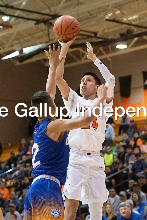 Gallup Bengal Quinn Atazhoon (24) takes a jump shot against the Bloomfield Bobcats Friday night at Gallup High School in Gallup. The Bengals took the win 78-56.