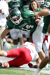 19 September 2015:  Justin Sheperd flies wide as Artie Checchin hops left during an NCAA division 3 football game between the Simpson College Storm and the Illinois Wesleyan Titans in Tucci Stadium on Wilder Field, Bloomington IL