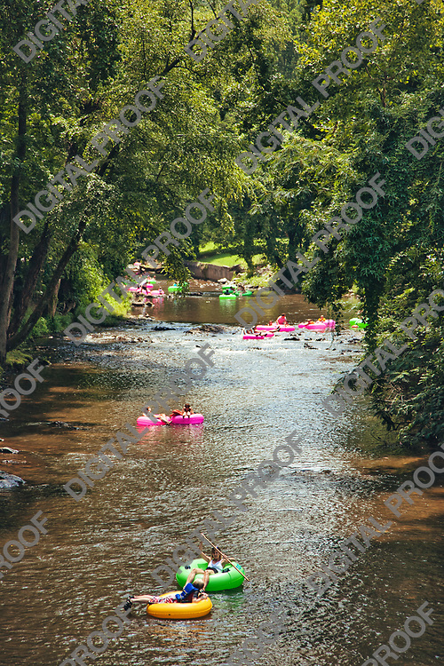 People doing river tubing at Helen town Georgia at daytime during summer