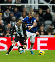 Football - 2019 / 2020 Premier League - Newcastle United vs. Everton<br /> <br /> Miguel Almiron of Newcastle United vies with Djibril Sidibe of Everton, at St James' Park Stadium.<br /> <br /> COLORSPORT/BRUCE WHITE